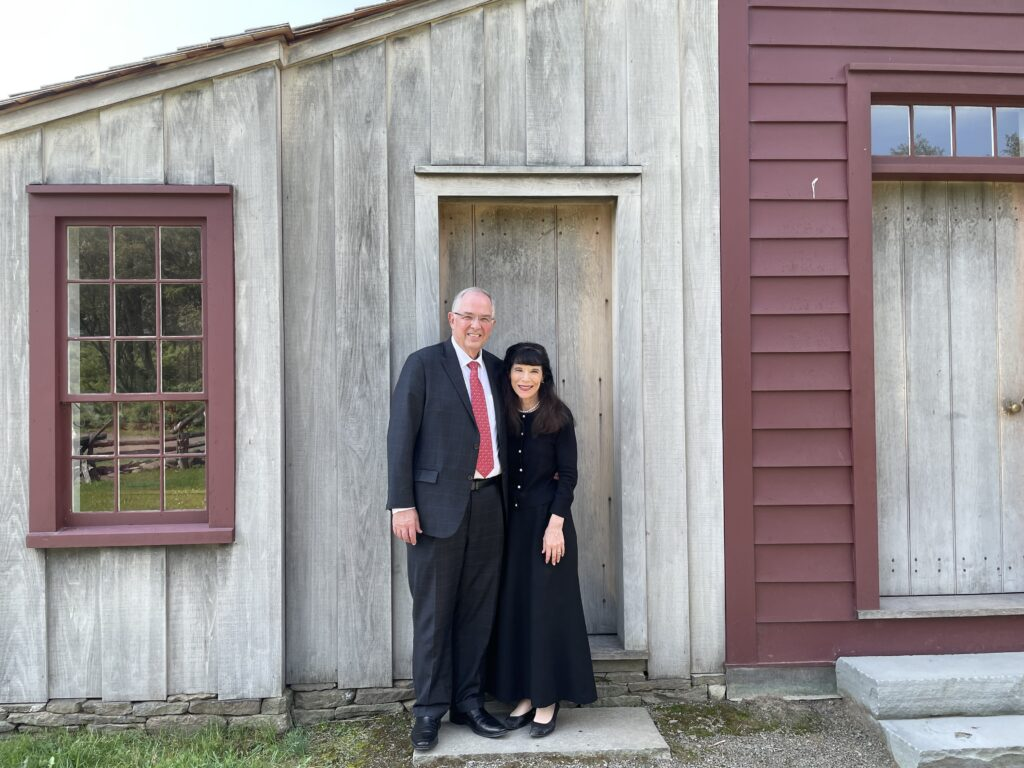 Elder Neil L. Andersen and Sister Kathy Andersen pose in front of the historical Joseph and Emma Smith home at the Priesthood Restoration Site in Oakland Township (Susquehanna), Pennsylvania, on Sunday, Aug. 29, 2021.
