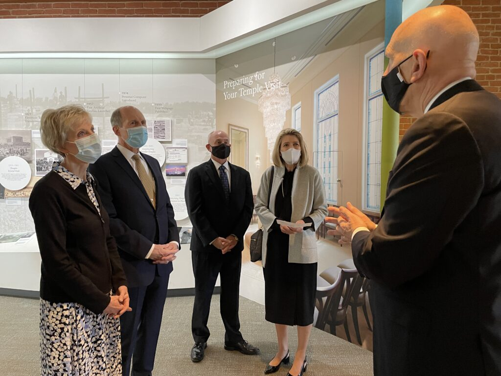 Relief Society General President Jean B. Bingham and her husband, Brother Bruce Bingham, left, Brother Douglas R. Johnson and Primary General President Camille N. Johnson listen as Historic Nauvoo Sites Mission President Stephen Rizley gives them a tour of the visitors' center on Friday, Sept. 24, 2021, in Nauvoo, Illinois.