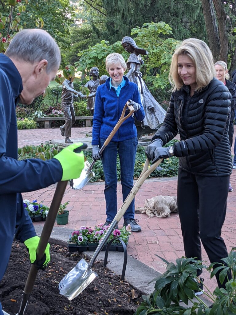Relief Society General President Jean B. Bingham, left, and Primary General President Camille N. Johnson prepare to plant flowers in the Monument to Women garden during a tour of historic Nauvoo, Illinois, on Saturday, Sept. 25, 2021.