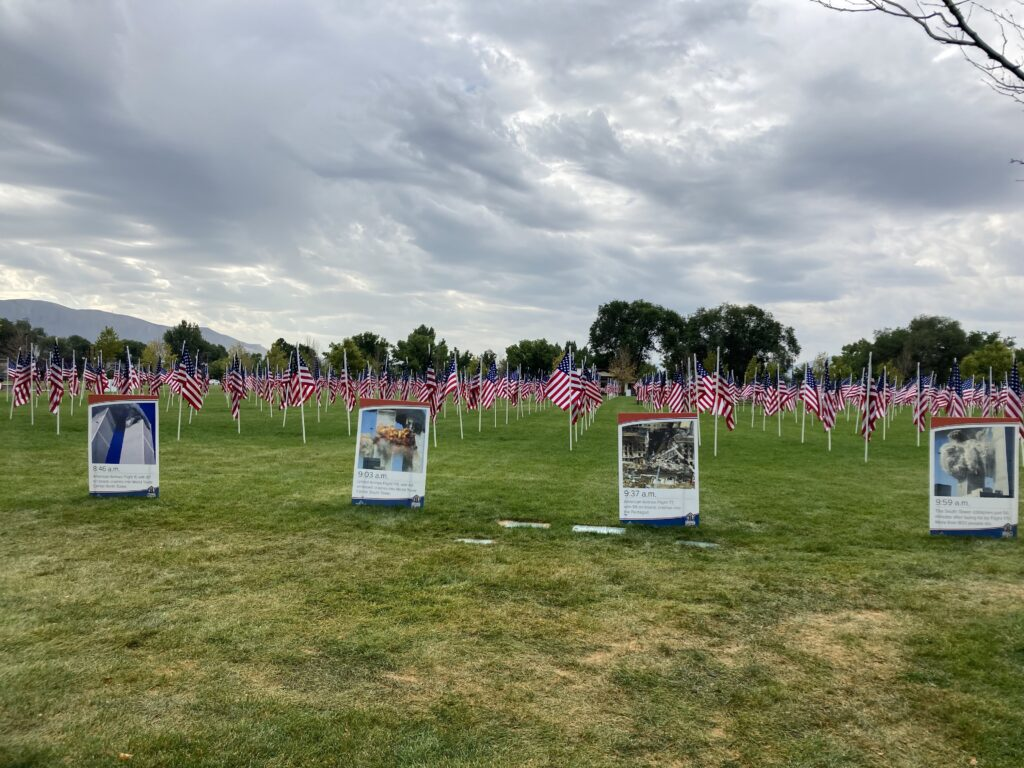 A display including 911 American flags and a timeline of events of the Sept. 11, 2001, terrorist attacks, line an open field at Riverton City Park on Saturday, Sept. 11, 2021 in honor of the 20th anniversary.