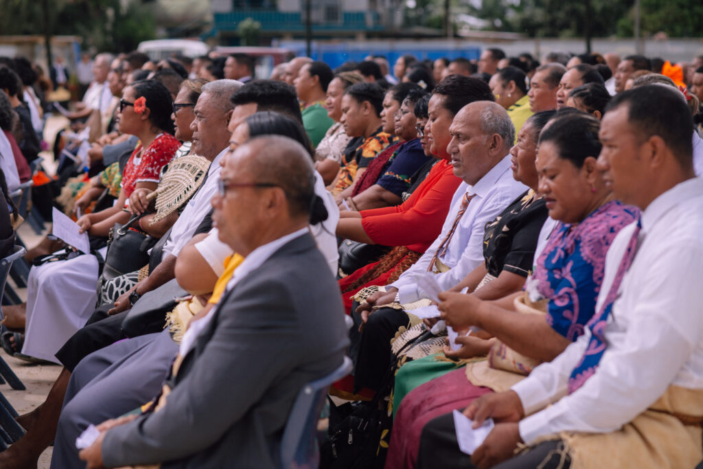 Attendees participate in the Neiafu Tonga Temple groundbreaking service on Sept. 11, 2021. More enjoyed a livestream of the proceedings in the adjacent church meetinghouse.