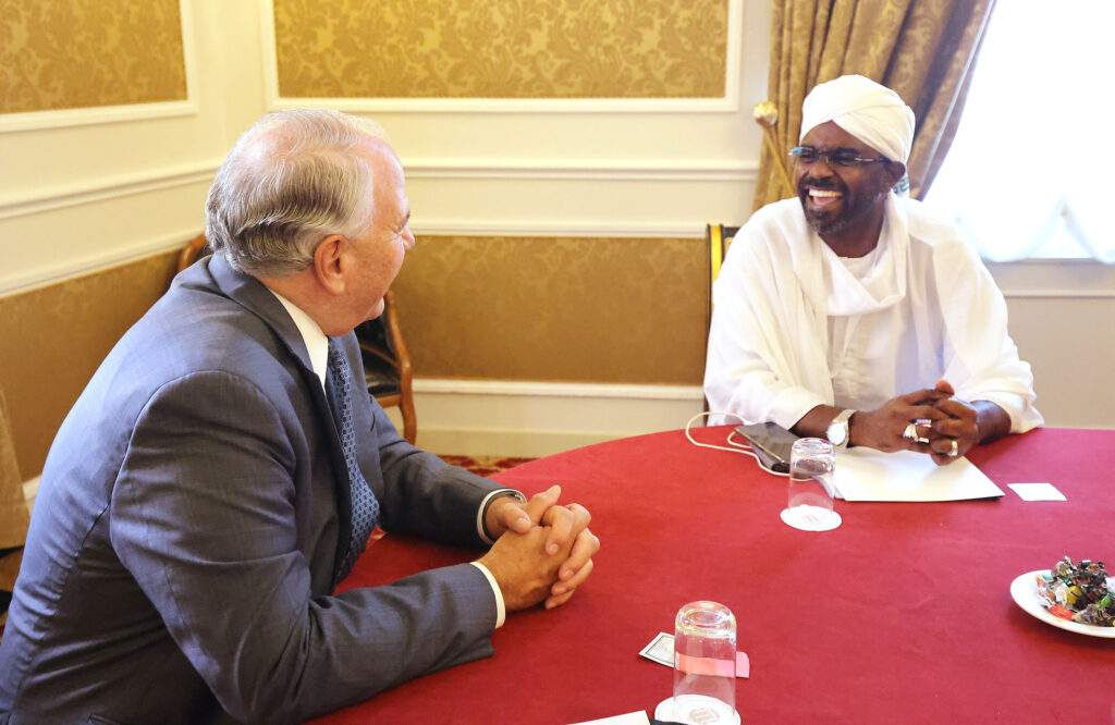 Elder Ronald A. Rasband, a member of the of Quorum of the Twelve Apostles of The Church of Jesus Christ of Latter-day Saints laughs while talking to Nasar-Eddin Mofarih, Sudan's minister of religious affairs, during the G20 Interfaith Forum in Bologna, Italy, on Sunday, Sept. 12, 2021.