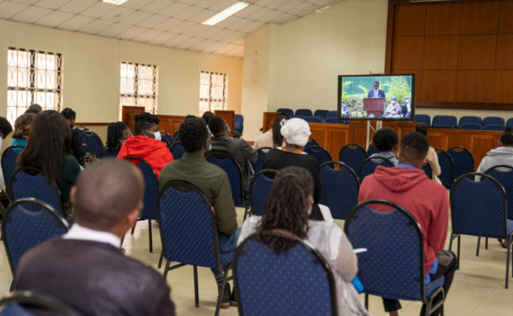 Members of the Mountain View Ward of the Nairobi Kenya West Stake watch the live streaming of the Nairobi Kenya Temple groundbreaking services in a meetinghouse on Sept. 11, 2021.