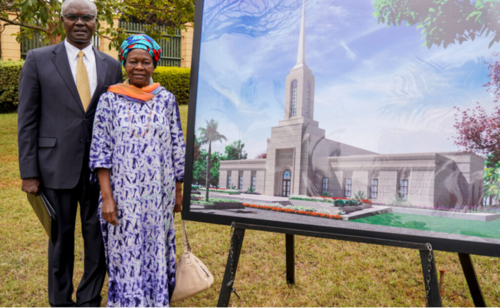 Elder Josephi Sitati and Sister Gladys Sitati stand with a rendering of the Kenya Nairobi Temple at groundbreaking services on Sept. 11, 2021.