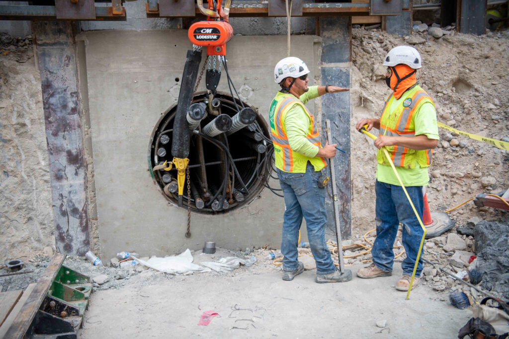 Construction workers fill the new pipes in the Salt Lake Temple foundation with reinforced steel, September 2021.