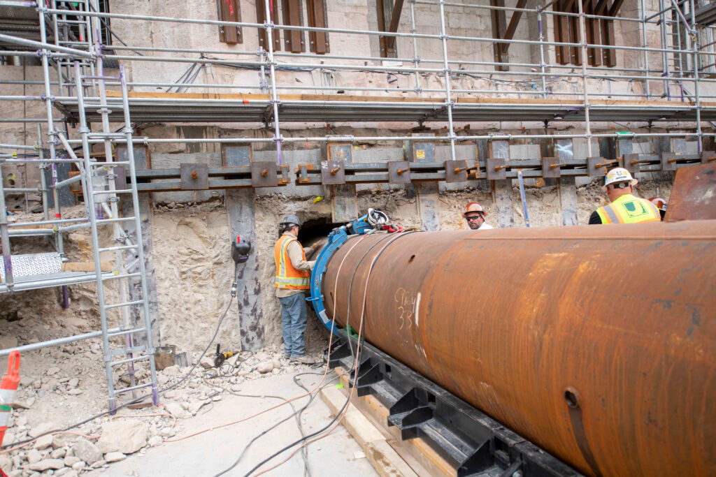 Forty-foot-long pipes are used to strengthen the temple's foundation against earthquakes, Salt Lake City, Utah, September 2021.