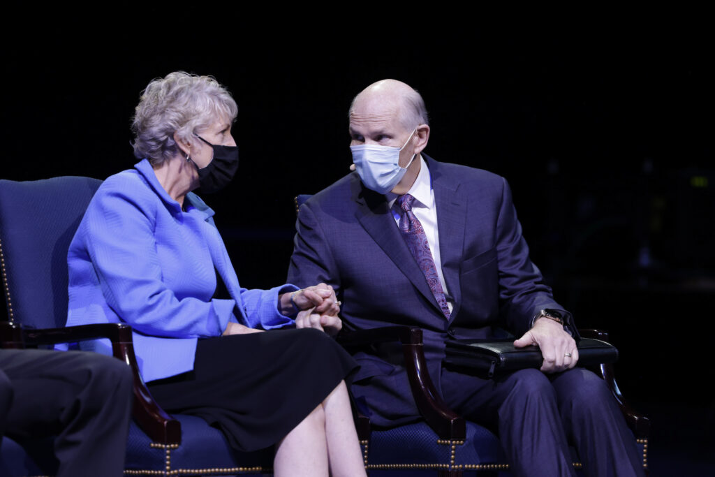 Elder Dale G. Renlund of the Quorum of the Twelve Apostles and his wife, Sister Ruth Renlund, talk together prior to the BYU campus devotional in the Marriott Center in Provo, Utah, on Tuesday, Sept. 14, 2021.