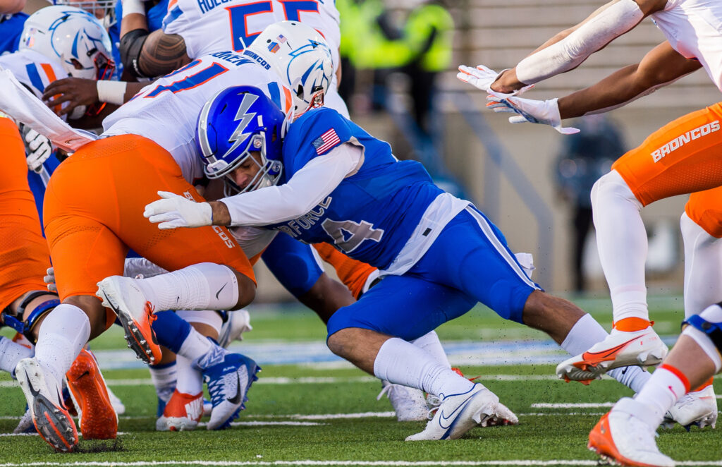 Returned missionary/Air Force Academy defensive back Ethan Erickson tackles a Boise State ball carrier during 2020 matchup in Colorado Springs, Colorado.