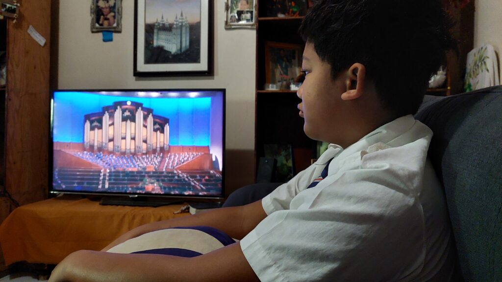 Manahau Lai-lau of the Haumi Ward, Tahiti Arue Stake, watches the Saturday morning session of the 191st Semiannual General Conference of The Church of Jesus Christ of Latter-day Saints, broadcast on Saturday, Oct. 2, 2021.