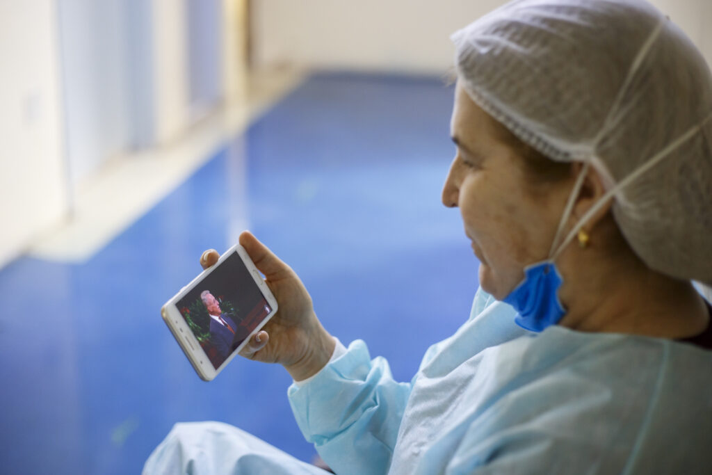 A healthcare worker in Brazil watches the Saturday morning session of the 191st Semiannual General Conference of The Church of Jesus Christ of Latter-day Saints, broadcast on Saturday, Oct. 2, 2021.