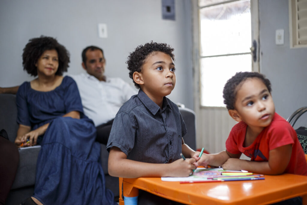 A family in Brasilia, Brazil, watches the Saturday morning session of the 191st Semiannual General Conference of The Church of Jesus Christ of Latter-day Saints, broadcast on Saturday, Oct. 2, 2021.