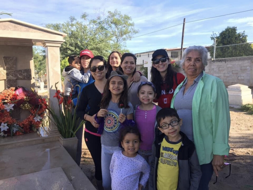 Extended members of the Guerrero family gather to decorate and clean the grave sites of family members during Day of the Dead in Mexico