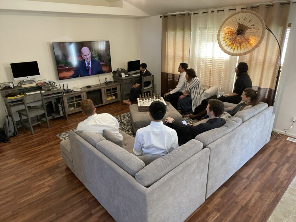 Elijah Galbraith, Zion Ong, Josh Hewitt, Sadie Burt, Nauvoo Ong, Yaling Brenda Ong, Jacob Ong, Isaiah Ong watch the Sunday morning session of the 191st Semiannual General Conference of The Church of Jesus Christ of Latter-day Saints on Oct. 3, 2021, from the Ong's home in the Saratoga Hills 4th Ward, Saratoga Hills Utah Stake.