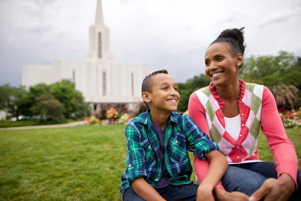 A mother and her son sit in front of a temple. Sister Nancy Dance and Sister Dana Wright, former members of the Primary general advisory council, wrote a digital-only article for the October Liahona about helping children prepare for the temple.