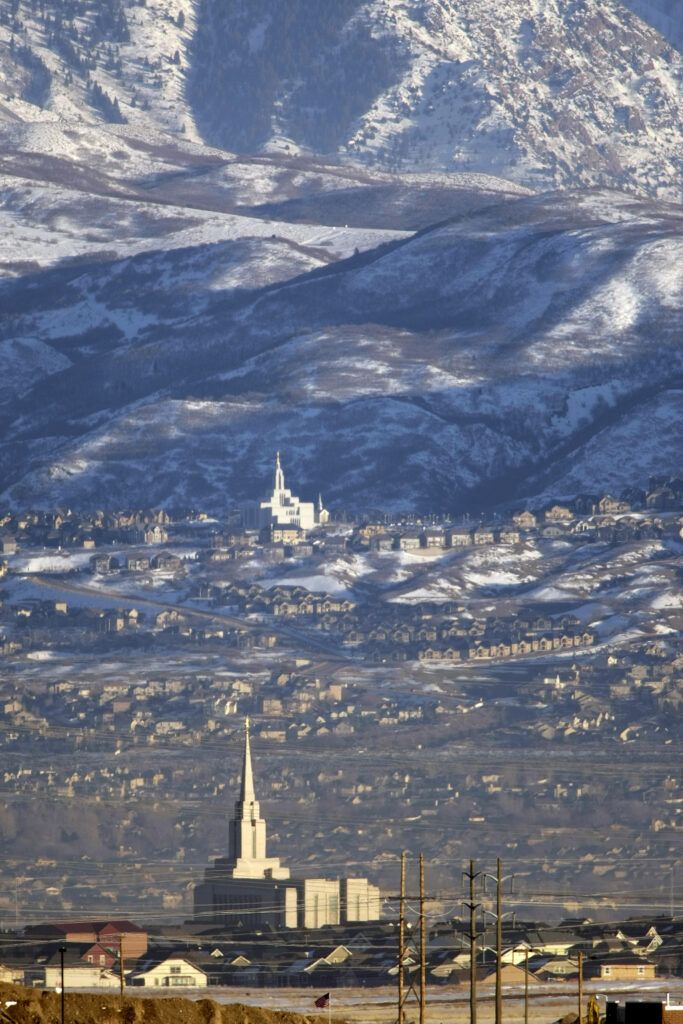 The Draper Utah (background) and the Oquirrh Mountain Utah temples, prior to each's dedication, in this January 2009 photo.