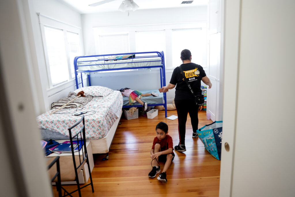 Lucy Navas tries to get her children, Allison Contreras Navas, 6, and Christopher Contreras Navas, 7, ready to leave their new apartment so she can go to work in Medford, Oregon, on Tuesday, Sept. 22, 2020. Navas, her two children and her parents lived together in a mobile home that burned to the ground in the Almeda Fire. Now they are sharing a two-bedroom apartment provided by a fellow member of The Church of Jesus Christ of Latter-day Saints.