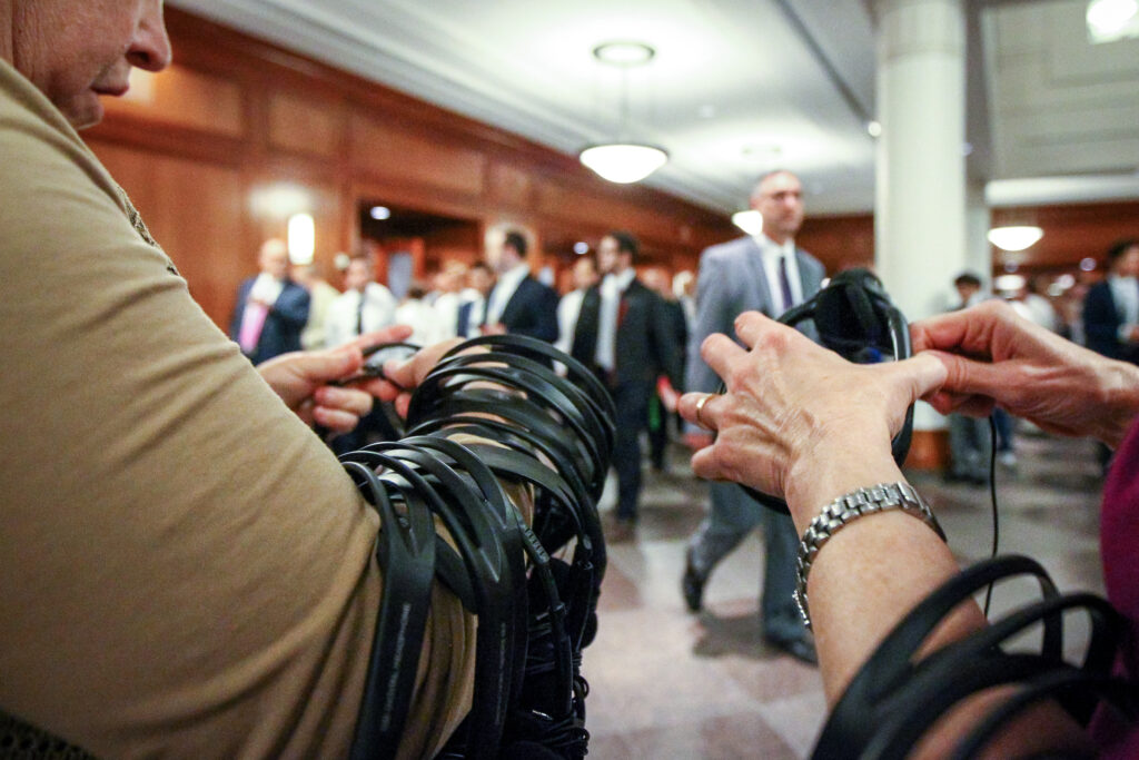 Volunteers collect translation headsets after the priesthood session of The Church of Jesus Christ of Latter-day Saints' 187th Semiannual General Conference in Salt Lake City on Saturday, Sept. 30, 2017.