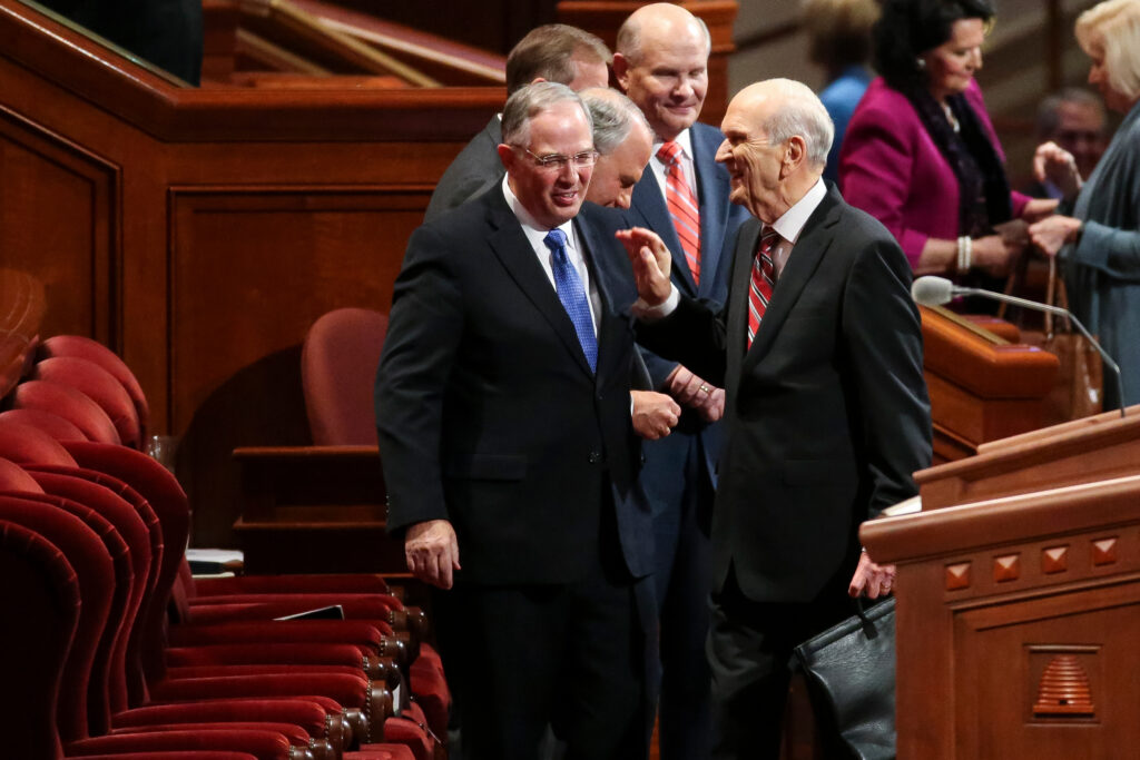 Elder Neil L. Andersen, left, and President Russell M. Nelson, then both of the Quorum of the Twelve, greet each other before the start of the Saturday afternoon session of the Church's 187th Semiannual General Conference in Salt Lake City on Saturday, Sept. 30, 2017.