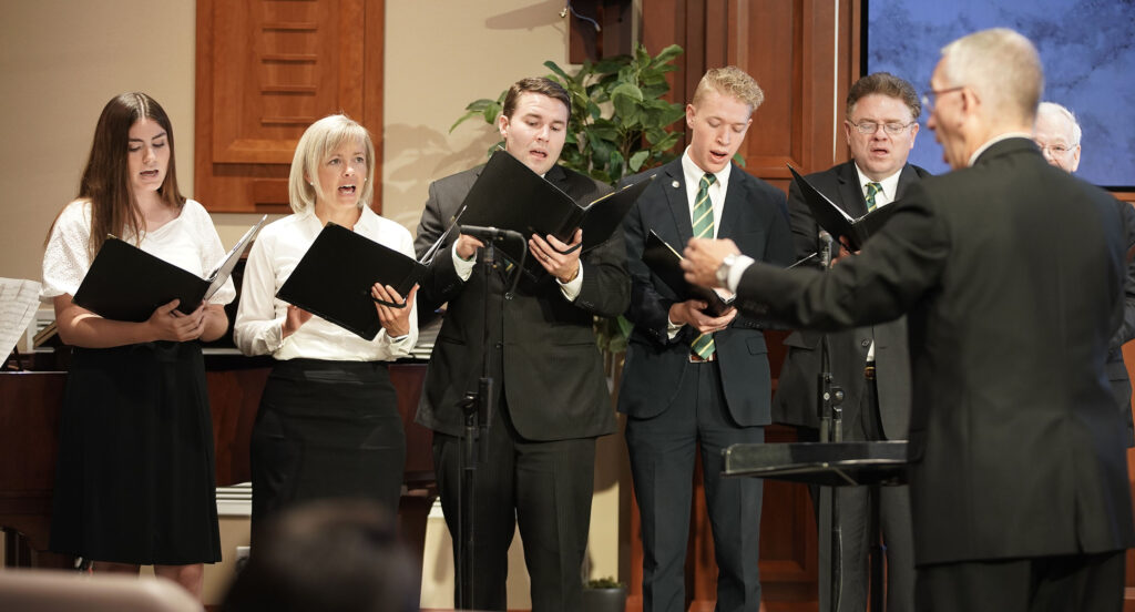 A choir sings during a Elder D. Todd Christofferson, of The Church of Jesus Christ of Latter-day Saints' Quorum of the Twelve Apostles, devotional at the Church Office Building auditorium in Salt Lake City on Tuesday, June 15, 2021. It was the first in-person devotional for the school since the pandemic began.