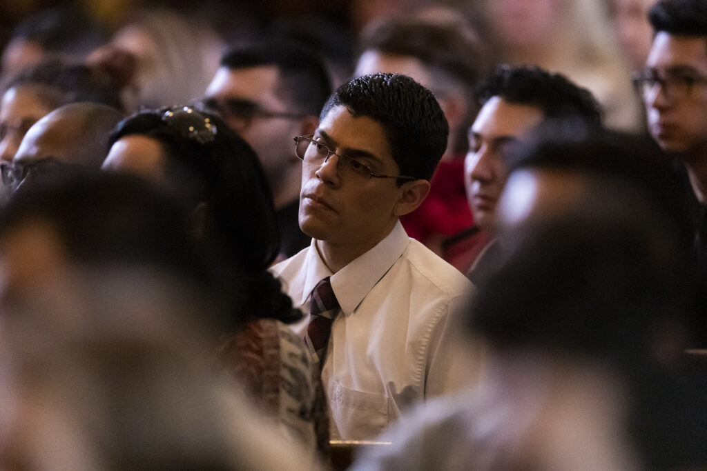 Audience members listen as Elder Ulisses Soares of the Quorum of the Twelve Apostles of The Church of Jesus Christ of Latter-day Saints, speaks to LDS Business College students during a devotional in the Assembly Hall on Temple Square in Salt Lake City on Tuesday, Jan. 28, 2020.