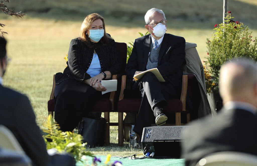 Sister Susan Gong, left, and her husband, Elder Gerrit W. Gong, a member of Quorum of the Twelve Apostles of The Church of Jesus Christ of Latter-day Saints, listen during the groundbreaking ceremony for the Taylorsville Utah Temple in Taylorsville on Saturday, Oct. 31, 2020.
