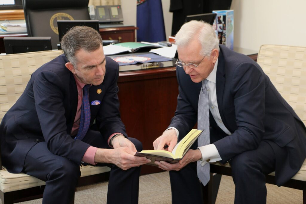 Elder D. Todd Christofferson of the Quorum of the Twelve Apostles gives Virginia Governor Ralph Northam a copy of the Book of Mormon in the governor's office in Richmond Tuesday, March 3, 2020.