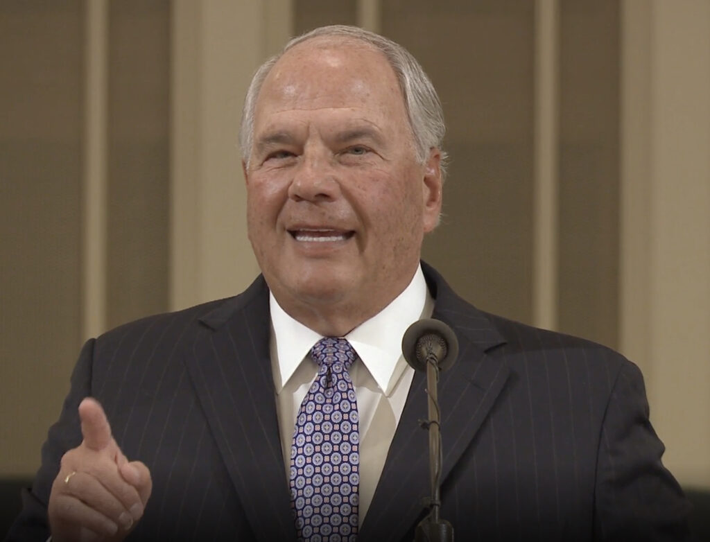 Elder Ronald A. Rasband of the Quorum of the Twelve Apostles makes a point while speaking in a missionary devotional streamed online on Jan. 14, 2021.