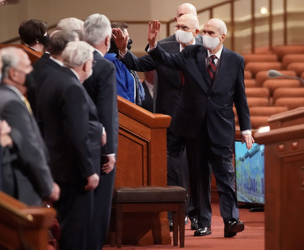 President Russell M. Nelson, president of The Church of Jesus Christ of Latter-day Saints, front right, waves to members of the Tabernacle Choir during the 191st Semiannual General Conference of at the Conference Center in Salt Lake City on Saturday, Oct. 2, 2021.