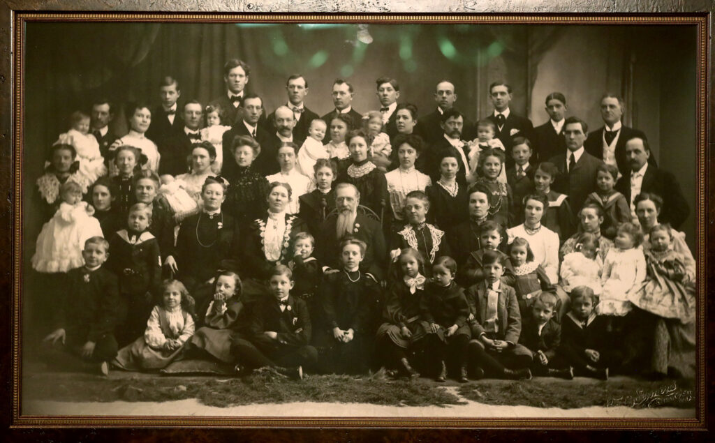 A family portrait hangs in a bedroom that has been refurbished to reflect Joseph F. Smith's bedroom in 1918 in the Beehive House in Salt Lake City on Wednesday, Sept. 22, 2021.