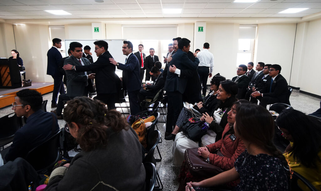 Missionaries and leaders greet before branch sacrament meeting at the Mexico Missionary Training Center of The Church of Jesus Christ of Latter-day Saints on Sunday, Jan. 26, 2020.