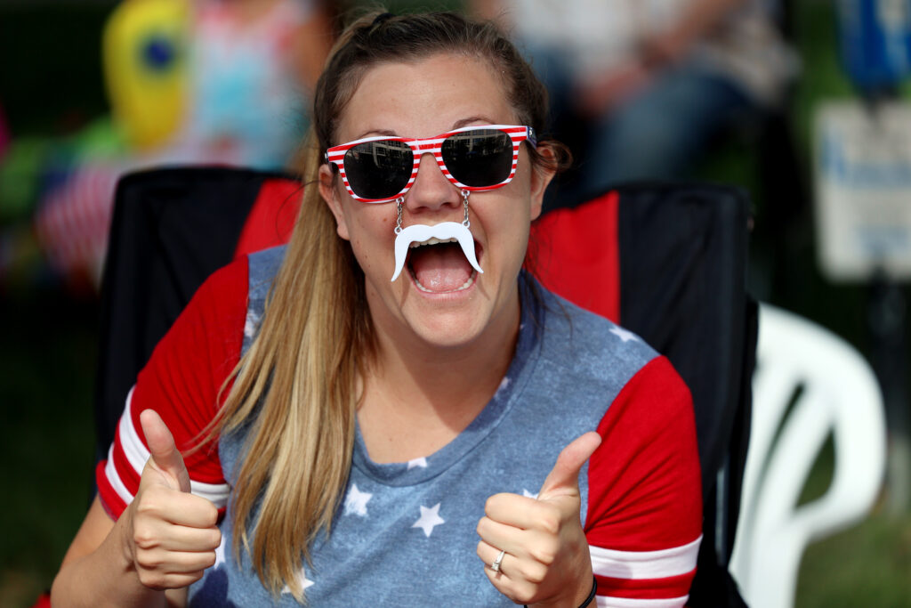 Stephanie Gardner, of Bountiful, enjoys the Days of '47 Parade in her sunglass and mustache in Salt Lake City on Friday, July 23, 2021.