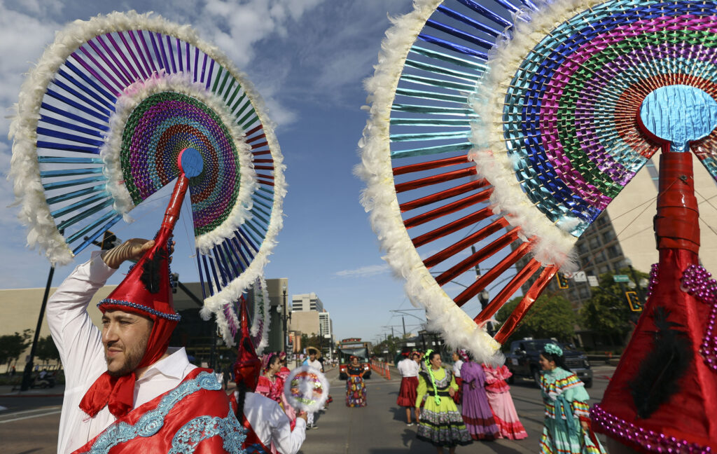 Jesus Rangel wears an Indigenous Pueblo penacho to march in the Days of '47 Parade with the Consulate of Mexico in Salt Lake City on Friday, July 23, 2021.