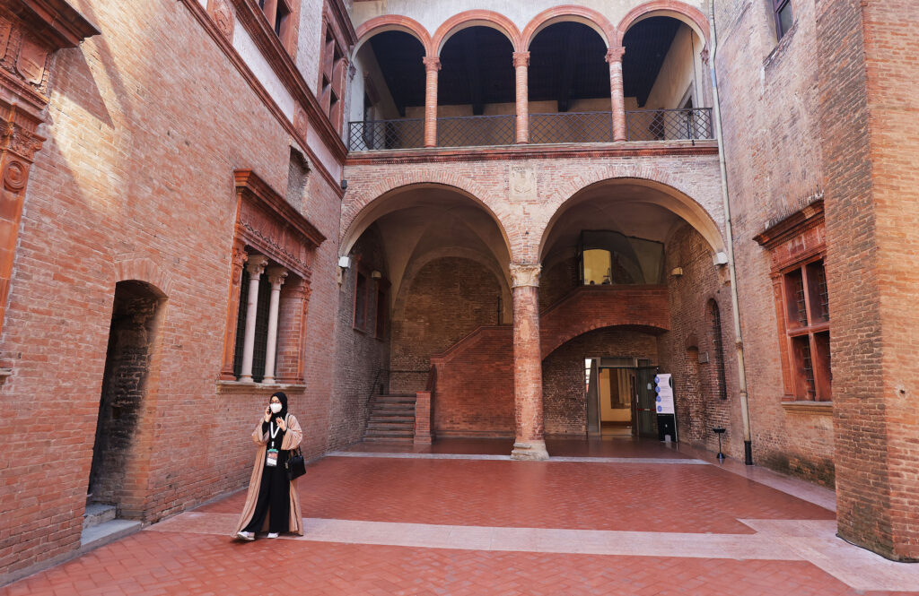 An attendee walks through the Palazzo Re Enzo during the G20 Interfaith Forum in Bologna, Italy on Monday, Sept. 13, 2021.