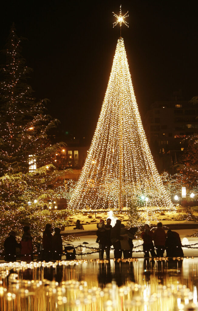 Hundreds wander as they look over Christmas lights on Temple Square in Salt Lake City, Utah, Friday, Nov. 26, 2010.