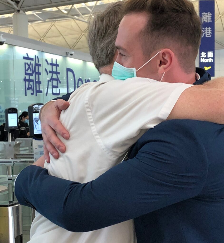President Dennis L. Phillips, left, of the China Hong Kong Mission embraces one of his elders at the airport prior to missionaries evacuating due to coronavirus concerns.The photo is one he included as a submission to the Church History Department's project of documenting missionary experiences during the 2020 COVID-19 pandemic, which drew 7,000 online entries from missionaries and mission leaders worldwide.