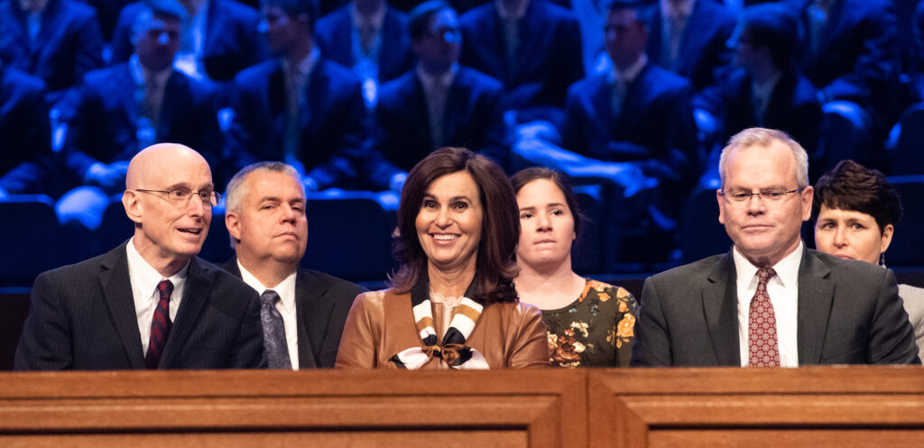 President Henry J. Eyring, left, Sister Lisa L. Harkness, center, and her husband, David S. Harkness, right, sit on the stand during a BYU–Idaho campus devotional on Tuesday, Feb. 11, 2020, in Rexburg, Idaho.