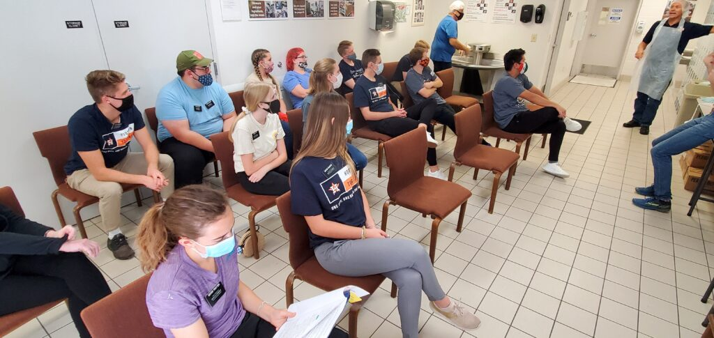 Missionaries from the Texas Houston Mission meet for orientation before beginning a peanut butter production shift at the Houston Cannery on Oct. 23, 2020.