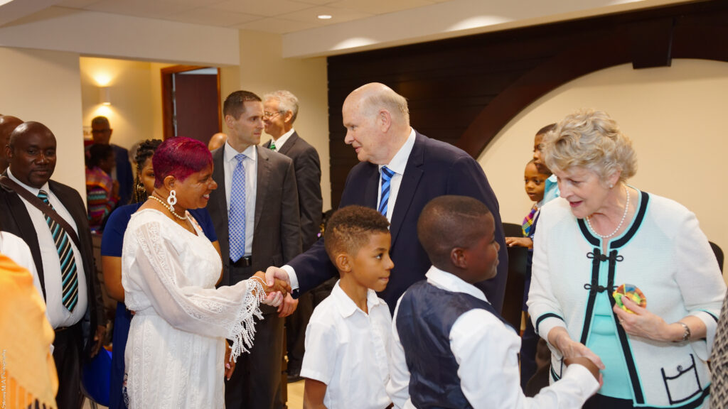 Elder Dale G. Renlund, center, and his wife, Sister Ruth Renlund, right, shake hands with members in Martinique following a meeting on Feb. 18, 2020. The apostle visited the Caribbean Area as part of the annual area review.