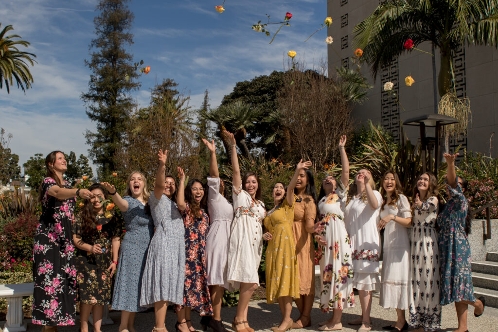 Attendees at the fourth annual International Women-in-Diplomacy Day, which was held at the Los Angeles California Temple Visitors' Center on Monday, March 9, 2020, celebrate by throwing flowers in the air.