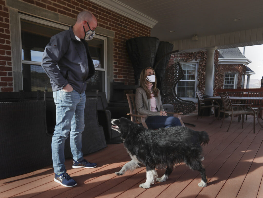 Gov.-elect Spencer Cox and his wife, future Utah first lady Abby Cox, are joined by their dog Shadow as they talk about the recent gubernatorial election from their family's farmland in Fairview, Sanpete County, on Wednesday, Dec. 9, 2020.