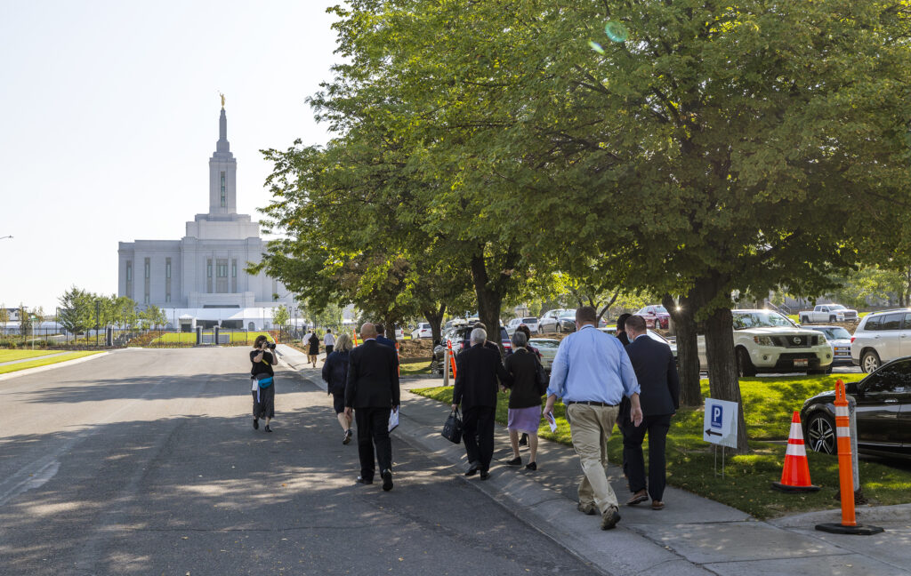Media members start out a walk to the Pocatello Idaho, temple of The Church of Jesus Christ of Latter-day Saints on Monday, Sept. 13, 2021.