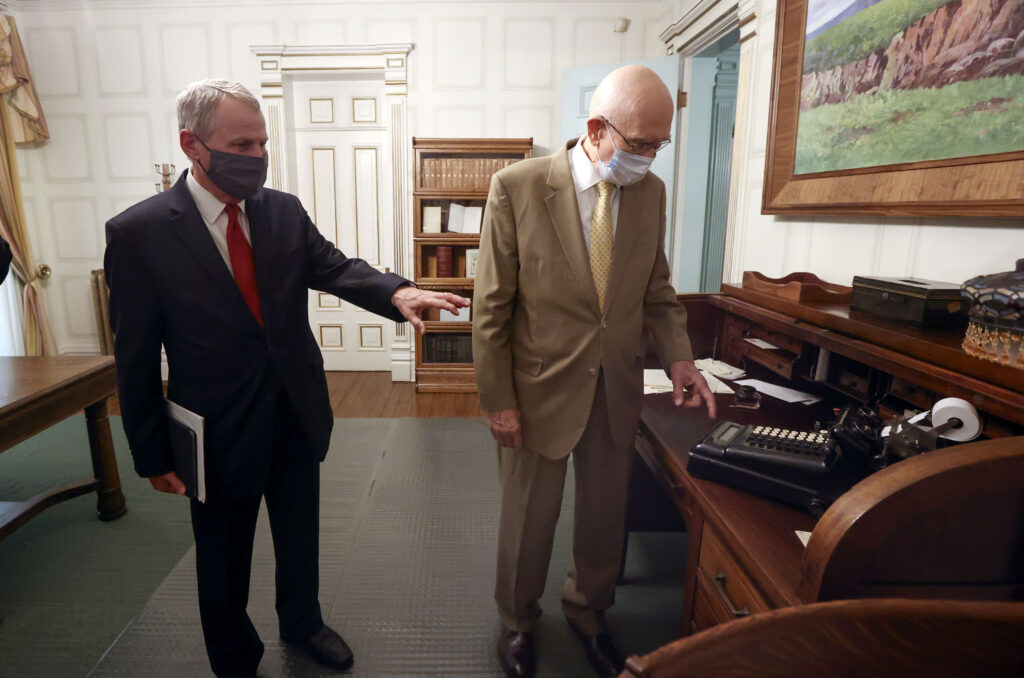 Elder LeGrand R. Curtis Jr., of the Seventy, and President Dallin H. Oaks, first counselor in the First Presidency, look at a typewriter while touring Joseph F. Smith's private office in the Beehive House in Salt Lake City on Friday, Sept. 24, 2021.