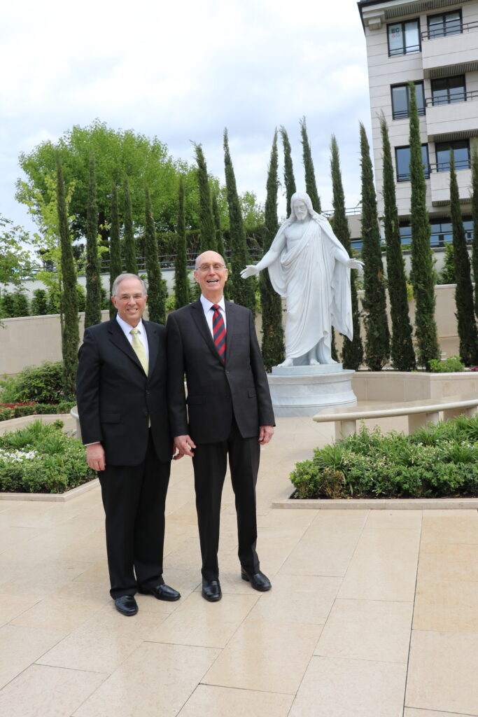 President Henry B. Eyring, first counselor in the First Presidency, right, with Elder Neil L. Andersen of the Quorum of the Twelve Apostles on the grounds of the Paris France Temple.