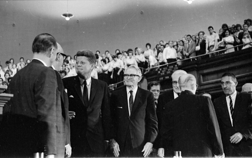 President John F. Kennedy talks to Cal Rollins, with President David O. McKay at right, after speaking in the Tabernacle in Salt Lake City in 1960.