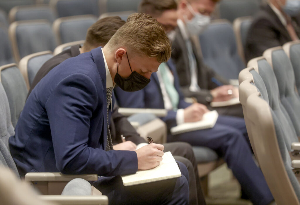 Elder Andrew Salway takes notes as Elder Jeffrey R. Holland, of The Church of Jesus Christ of Latter-day Saints' Quorum of the Twelve Apostles, delivers a missionary devotional on Wednesday, March 17, 2021.
