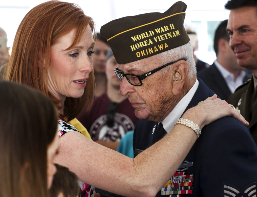 Jennie Taylor hugs Bob Ramos, a veteran of World War II, the Korean War and the Vietnam War, during dedication ceremony for the newly renamed Major Brent Taylor Vet Center Outstation in North Ogden on Monday, June 10, 2019. Brent Taylor was killed while serving in the Utah National Guard in Afghanistan in 2018.