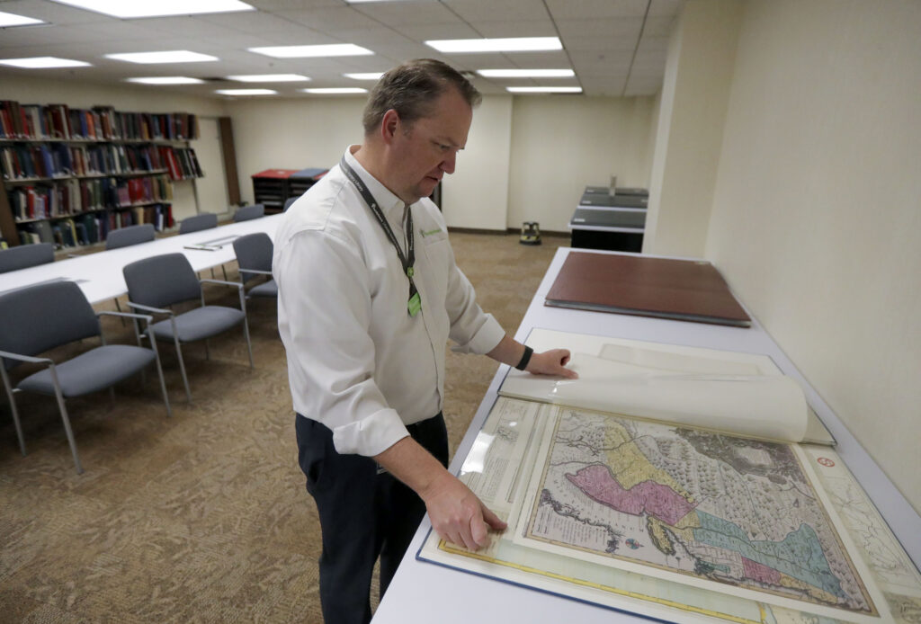 Lynn Turner, assistant director of The Church of Jesus Christ of Latter-day Saints' Family History Library, shows a historical map of New Jersey in the new map room at the library in Salt Lake City on Tuesday, June 29, 2021.