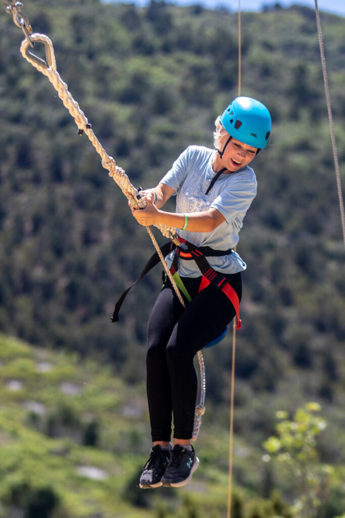 Tailynn Minchey, 14, swings on a ropes course at Badger Mountain in Ephraim Canyon, Utah, for the Snow Fun! Youth Conference on Thursday, June 3, 2021.