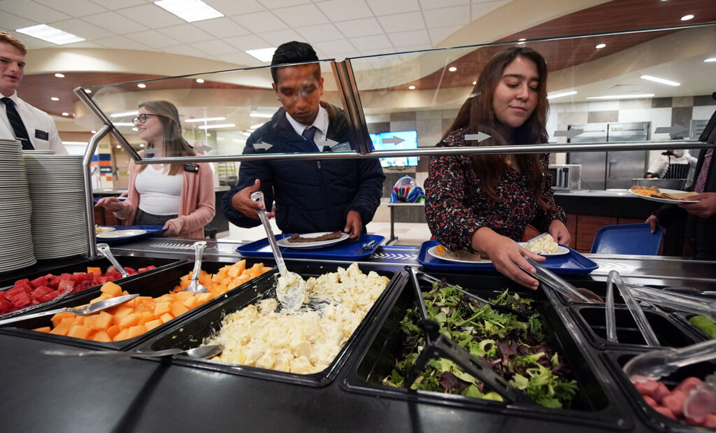 Missionaries dish up food in the cafeteria of the Mexico Missionary Training Center of The Church of Jesus Christ of Latter-day Saints on Friday, Jan. 24, 2020.