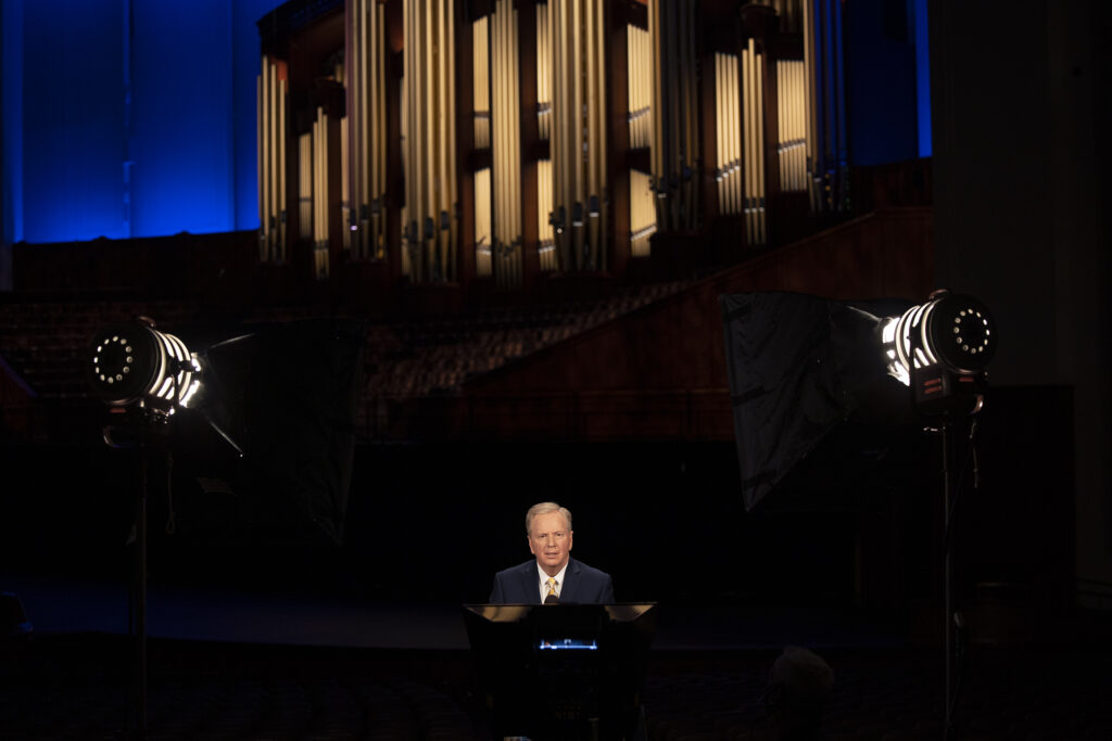 """Lloyd Newell records several upcoming portions of """"Music & the Spoken Word"""" inside the Conference Center in Salt Lake City on Wednesday, April 7, 2021. Newell is celebrating his 30th anniversary as announcer of the Tabernacle Choir at Temple Square."""